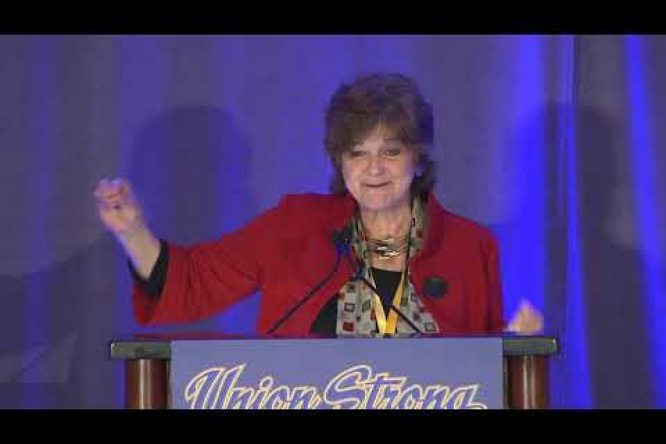 Historian Nancy MacLean speaks to delegates