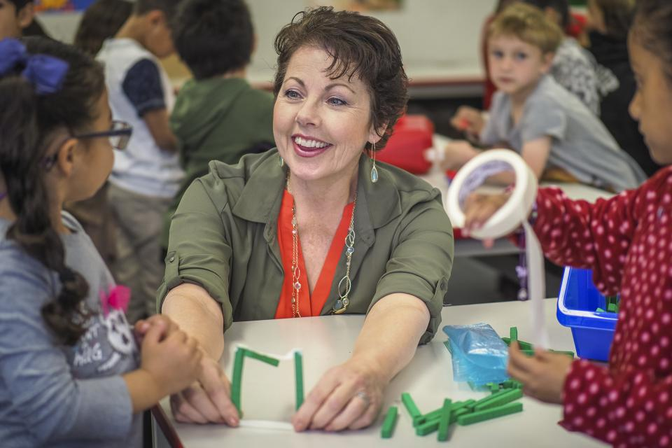 Laura Manriquez, who won a grant to help cover the cost of getting a teaching credential, working with kindergarteners at Aliso Elementary.